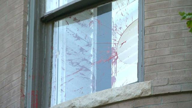 Red paint splattered on a window at Mayor Krewson's home after it was vandalized (Credit  KMOV)