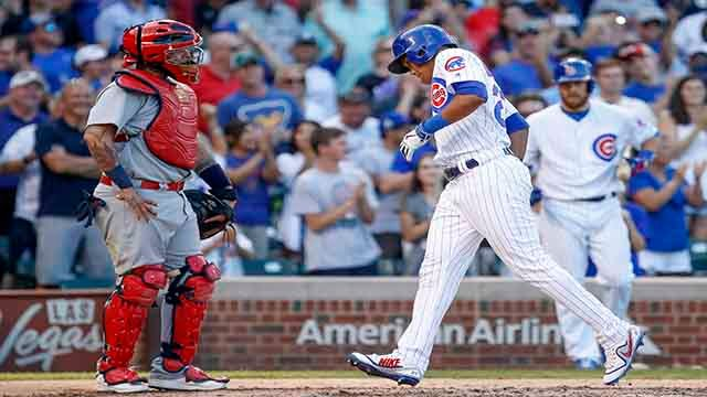 Chicago Cubs' Addison Russell crosses home plate after hitting a solo home run off St. Louis Cardinals' Tyler Lyons during the eighth inning of a baseball game, Saturday, Sept. 16, 2017, in Chicago. (AP Photo/Kamil Krzaczynski)