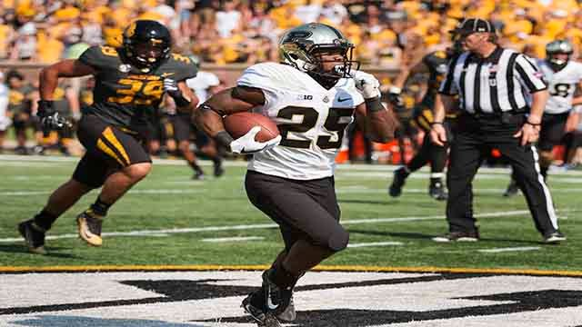 Purdue's Tario Fuller right outruns Missouri's Chris Turner left during the first half of an NCAA college football game Saturday Sept. 16 2017 in Columbia Mo