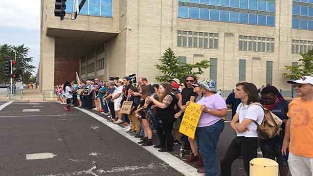 Protesters gather near the St. Louis Metropolitan Police Department headquarters (Credit: Alexis Zotos/KMOV)