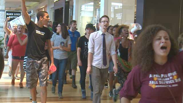 Protesters march and chant at West County Mall on September 16. Credit: KMOV
