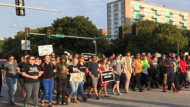 Protesters silently marched down Market Street  Monday (Credit: KMOV)
