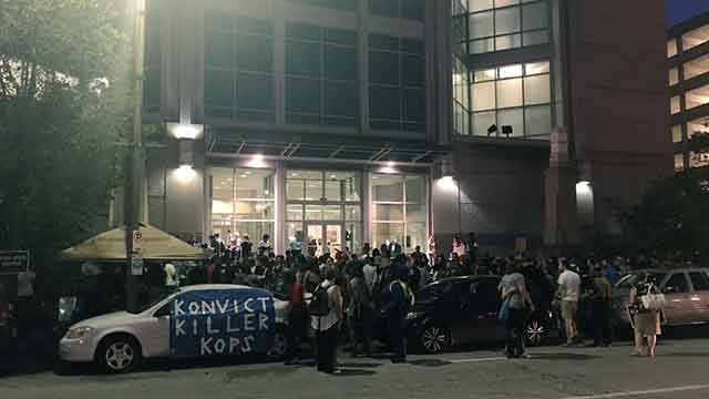 Hundreds are outside the St. Louis Justice Center to protest the not guilty verdict in the Jason Stockley trial. Credit: KMOV