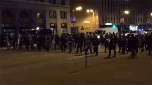 Police in riot gear in downtown St. Louis.  Credit: KMOV