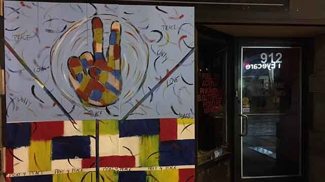 Broken storefront windows along Olive Street in downtown St. Louis were transformed into art within less than 24 hours after the damage. Credit: KMOV