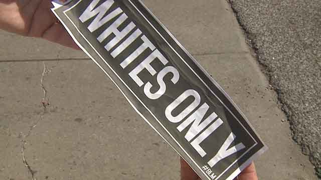"""Whites Only"" stickers were found on the doors of restaurants in The Grove Tuesday. Credit: KMOV"