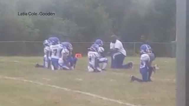 A group of little league football players in the Metro East is attracting attention afte they kneeled during the national anthem. (Credit: KMOV)