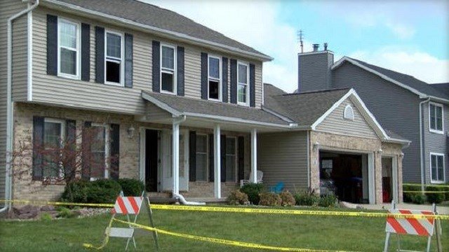 The Bloomington, Ill. home where police say a father strangled his two young children as his wife slept, and then set the home on fire  WMBD