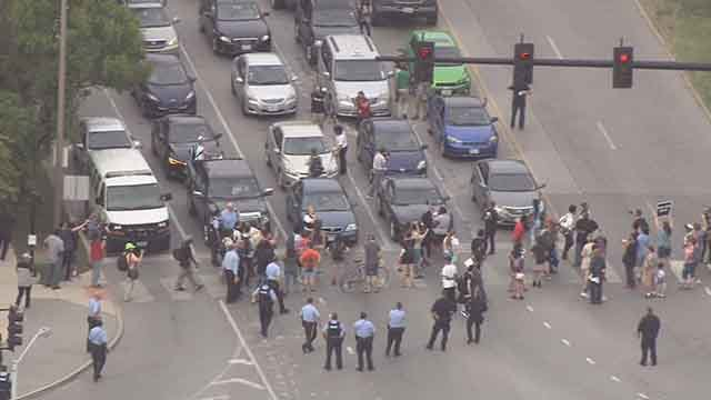 Protesters briefly block the intersection of Clayton and Skinker Thursday afternoon. Credit: KMOV