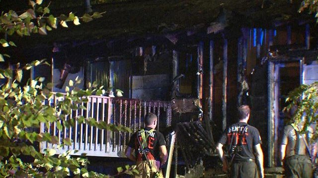 Firefighters on Greenmar Drive after a house fire Friday morning (Credit: KMOV)