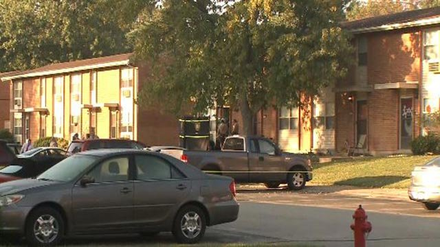 Crime scene tape and St. Louis County officers in the 300 block of Shadwell Drive Friday (Credit: KMOV)