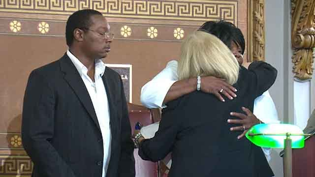 St. Louis Mayor Lyda Krewson hugs Annie Smith, mother of Anthony Lamar Smith, after a resolution was passed in Anthony's memory (Credit: KMOV)
