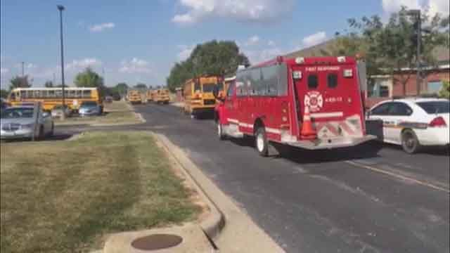 An ambulance arrives to treat students from Cahokia students who got sick on a field trip Friday. Credit: KMOV