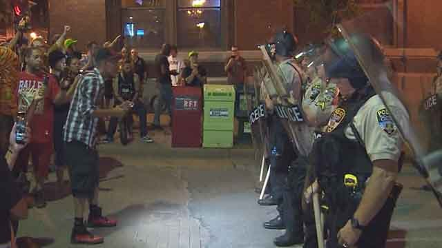 Protesters and officers face-to-face in St. Charles on Friday night. Credit: KMOV