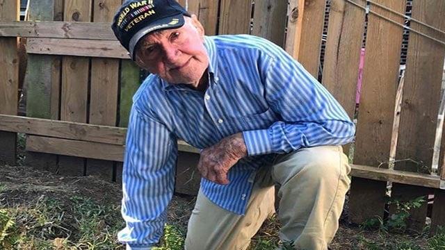 John Middlemas keeling while wearing a veteran's cap (Credit: Brennan Gilmore / Twitter)