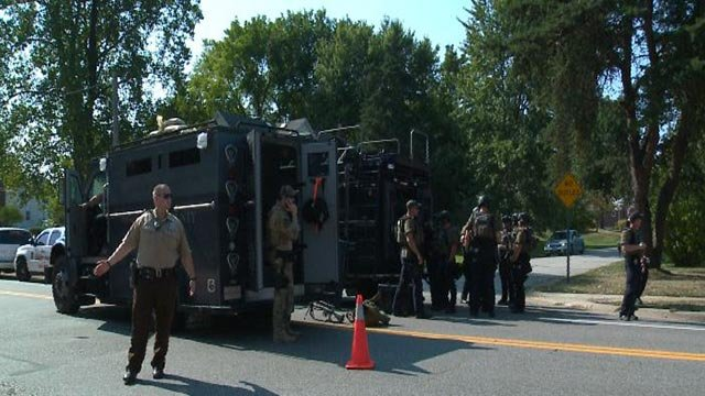 Police outside a standoff near Mattis and Valmeyer in south St. Louis County (Credit: KMOV)