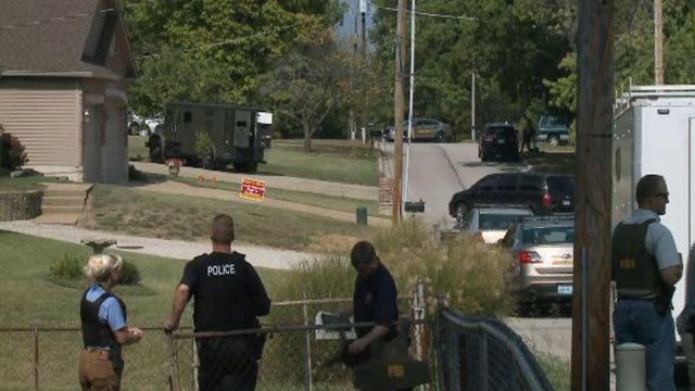 Heavy police presence outside an Arnold home Monday (Credit: KMOV)