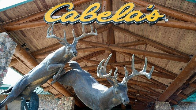 In this Sept. 19, 2017 photo, Cabela's logo is seen at the entrance to a store in La Vista, Neb. Bass Pro Shops' roughly $4 billion acquisition of rival (Credit:AP)