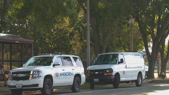 Police outside the Shepard Apartments following a stabbing Tuesday (Credit: KMOV)