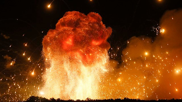 A powerful explosion is seen in the ammunition depot at a military base in Kalynivka, Ukraine early Wednesday, Sept. 27, 2017. Ukrainian officials say they have evacuated more than 30,000 people. (Credit: Efrem Lukatsky)