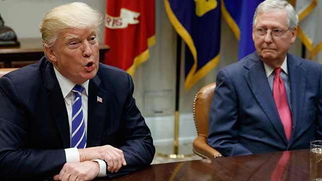 Senate Majority Leader Mitch McConnell, R-Ky., right, listens as President Donald Trump speaks during a meeting with Congressional leaders. (AP Photo/Evan Vucci)