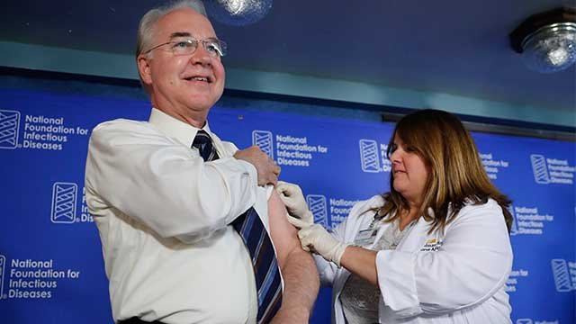 HHS Secretary Tom Price, left, receives a flu vaccination from Sharon Walsh-Bonadies, RN., right during a news conference recommending everyone age six months an older be vaccinated against influenza each year, Thursday, Sept. 28, 2017 in Washington. (AP)