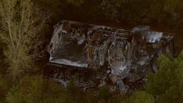 A cabin at Camp Wyman was damaged by fire Friday morning (Credit: KMOV)