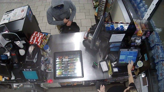 Surveillance shows the robbery at a Circle K in Fenton. Police are looking for the suspect. (Credit: Jefferson County Sheriff's Office)