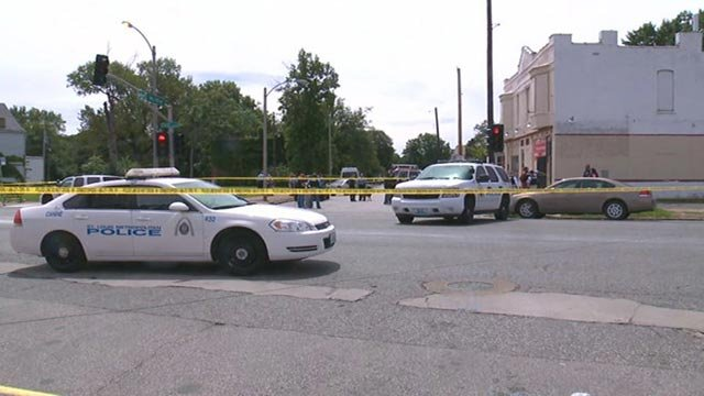Police on Walton after Mansur Ball-Bey was fatally shot on Aug. 19, 2015 (Credit: KMOV)
