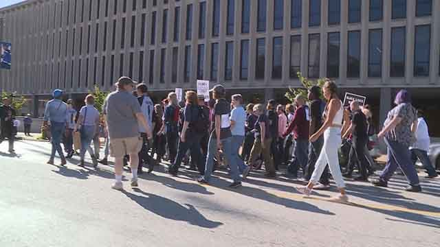 Activists came together outside City Hall to say they will not stop on-going demonstrations and protests. (Credit: KMOV)