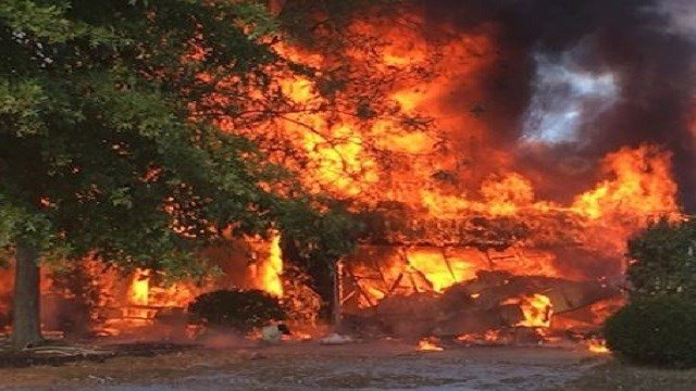 Multiple fire departments were called to help battle a house explosion south of Waterloo, Ill. (Credit: Republic Times)