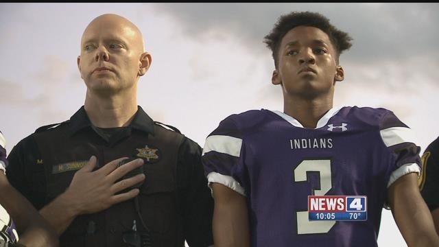 Mascoutah football players and coaches walked onto the field with law enforcement officers on Friday. Credit: KMOV