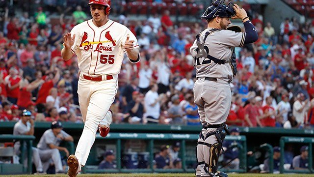St. Louis Cardinals' Stephen Piscotty (55) celebrates as he scores past Milwaukee Brewers catcher Stephen Vogt, right, on a double by Harrison Bader during the eighth inning of a baseball game Saturday, Sept. 30, 2017, in St. Louis. (AP Photo)