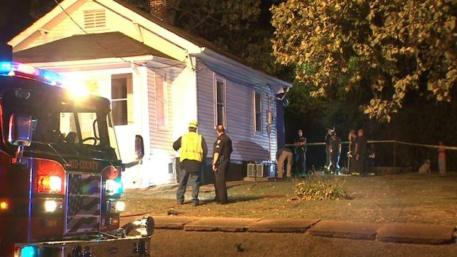 Firefighters at a home on Hobart Avenue after a fire overnight (Credit: KMOV)