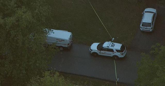 Police vehicles outside a Spanish Lake home after a double shooting Tuesday (Credit: KMOV)