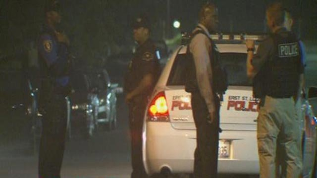 Police on the scene after a man was killed in East St. Louis Wednesday (Credit: KMOV)