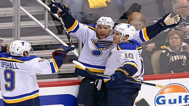 t. Louis Blues' Alex Pietrangelo (27) celebrates his game-winning goal with Brayden Schenn (10) and Scottie Upshall (9) in the overtime period (Credit: AP Photo / Gene J. Puskar)