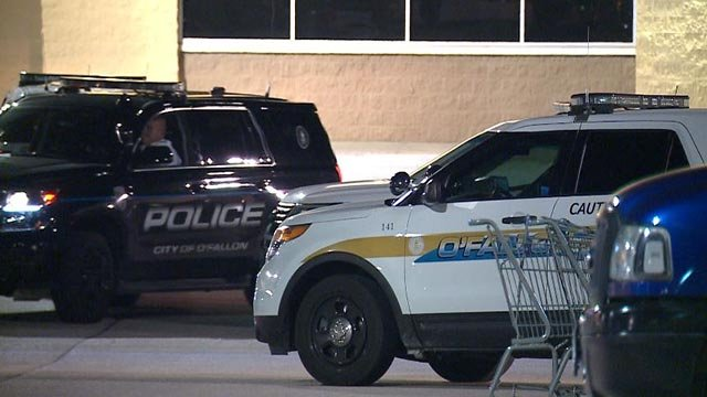 Police outside the O'Fallon Walmart after a man barricaded himself in a car (Credit: KMOV)