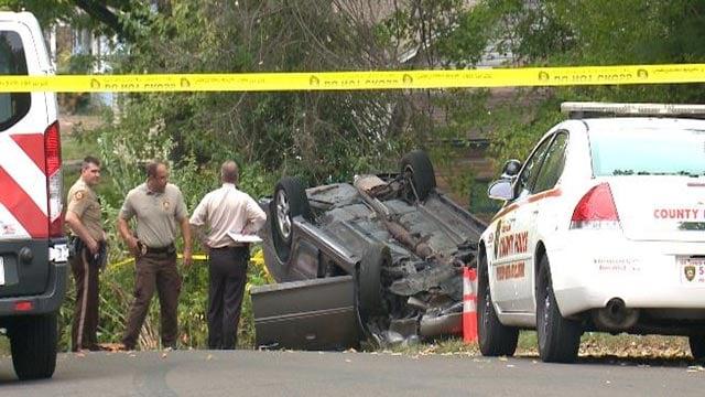 Police on Earl Drive after a car crash Friday (Credit: KMOV)