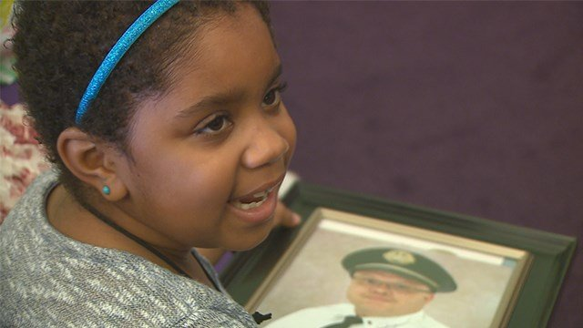 Deniya Irving four months after being shot along side her mother, father and uncle in June. (Credit: KMOV)