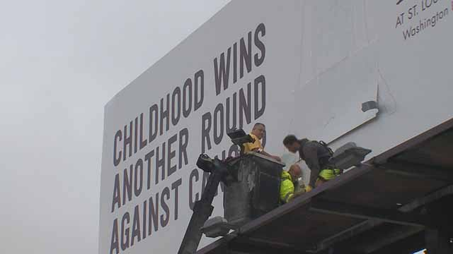 This new billboard will highlight kids who complete chemo at Children's Hospital. Credit: KMOV