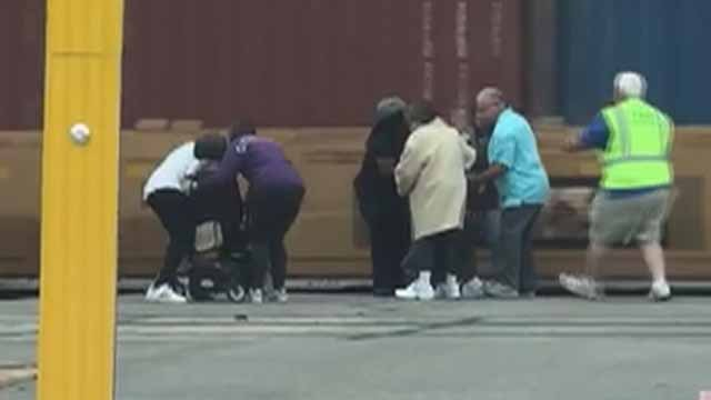 Bystanders rushed to pull a man in a wheelchair off train tracks in Kirkwood right before a train approached. Credit: KMOV