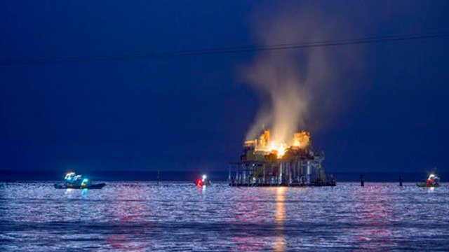 An oil rig explosion on a lake north of New Orleans, apparently caused when cleaning chemicals ignited, injured seven people and left authorities searching for another who was missing.