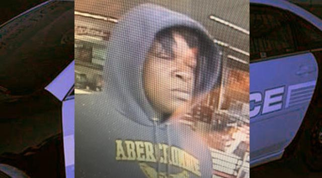 Surveillance photo of suspect who threw liquor bottles at employees of a Godfrey Schnucks on Oct. 17 (Credit: Madison County Sheriff's Office)