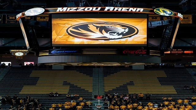 Missouri fans walk into Mizzou Arena to see the unveiling of the new scoreboard before the start of an NCAA college exhibition basketball game (Credit: Associated Press)