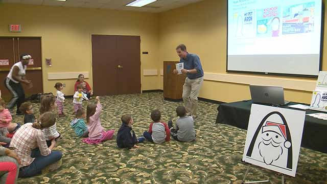 Ryan Nusebickel reading his book, the 12 Days of Christmas, to kids at the St. Louis Public Library on South Grand. Credit: KMOV