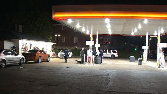 Investigators at a gas station on South Grand after a man was killed Wednesday (Credit: KMOV)