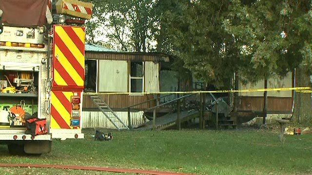 A body was found inside a burned mobile home in the 34000 block of Crystal Lake Road in Brighton, Illinois Friday (Credit: KMOV)