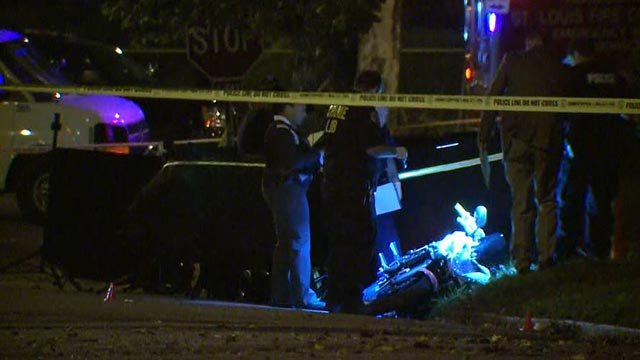 Investigators in the area of Minnesota and Bellerive after a double homicide early Tuesday morning (Credit: KMOV)