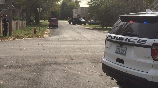 Police and SWAT outside a home in Highland Tuesday (Credit: Bryce Moore)